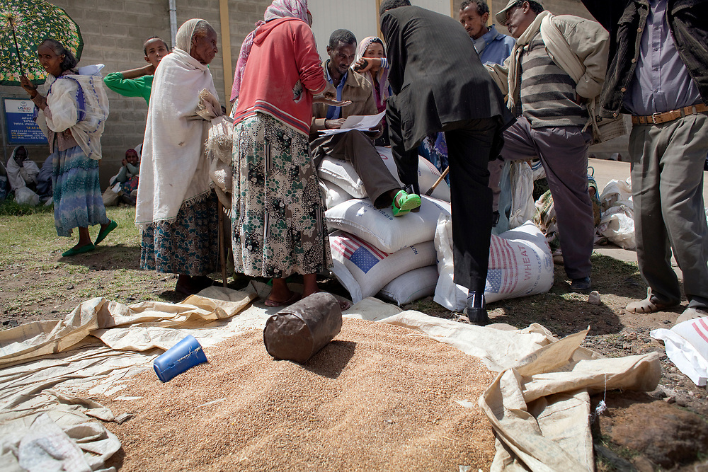 A group of people discussing the distribution of food aid, Adigrat.