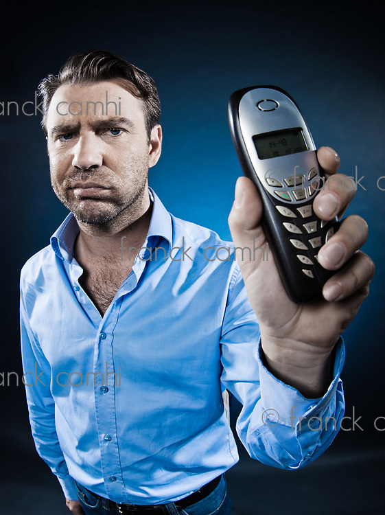 caucasian man show phone sulk unshaven portrait isolated studio on black background