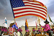 12 MAY 2001 -- PAYSON, AZ: The American flag blowing before a thunderstorm at the annual rodeo in Payson, AZ. PHOTO BY JACK KURTZ