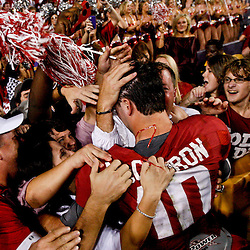 November 3, 2012; Baton Rouge, LA, USA; Alabama Crimson Tide quarterback AJ McCarron (10) celebrates with fans in the stands following a win over the LSU Tigers in a game at Tiger Stadium. Alabama defeated LSU 21-17. Mandatory Credit: Derick E. Hingle-US PRESSWIRE