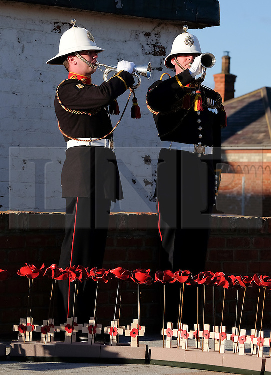 © Licensed to London News Pictures. <br /> 16/12/2014. <br /> <br /> Hartlepool, United Kingdom<br /> <br /> Buglers from the Royal Marines play the Last Post during an event to commemorate the bombardment of Hartlepool by German warships during World War One. During the bombardment 130 civilians were killed and more than 500 were wounded. The Headland's Heugh Gun Battery returned fire in what was the only battle to be fought on British soil during World War One, and one of the Battery's soldiers, Theo Jones of the Durham Light Infantry, became the first British soldier to be killed by enemy action on home ground in the war.<br /> <br /> Photo credit : Ian Forsyth/LNP