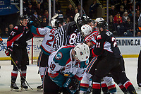 KELOWNA, CANADA - MARCH 14:  Ice officials try to restore order on the ice after a line brawl during third period between the Prince George Cougars and the Kelowna Rockets on March 14, 2018 at Prospera Place in Kelowna, British Columbia, Canada.  (Photo by Marissa Baecker/Shoot the Breeze)  *** Local Caption ***