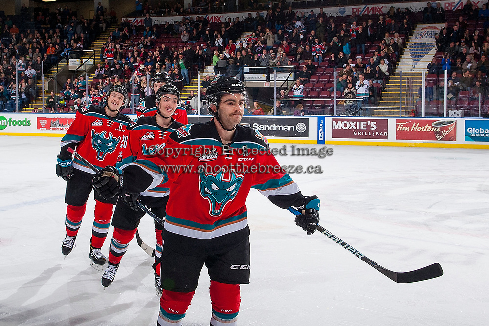 KELOWNA, CANADA - NOVEMBER 29: Gordie Ballhorn #4, Liam Kindree #26 and Dillon Dube #19 of the Kelowna Rockets skate to the bench to celebrate a goal against the Prince George Cougars on November 29, 2017 at Prospera Place in Kelowna, British Columbia, Canada.  (Photo by Marissa Baecker/Shoot the Breeze)  *** Local Caption ***