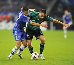 Chelsea's Eden Hazard is fouled by FC Schalke 04 Christian Clemens - Photo mandatory by-line: Joe Meredith/JMP - Tel: Mobile: 07966 386802 22/10/2013 - SPORT - FOOTBALL - Veltins-Arena - Gelsenkirchen - FC Schalke 04 v Chelsea - CHAMPIONS LEAGUE - GROUP E