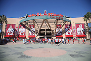 ANAHEIM, CA - AUGUST 29:  Fans cue up to enter the stadium in this general view photo of the exterior main entrance taken before the Los Angeles Angels of Anaheim game against the Oakland Athletics at Angel Stadium on Saturday, August 30, 2014 in Anaheim, California. The Angels won the game in a 2-0 shutout. (Photo by Paul Spinelli/MLB Photos via Getty Images)