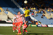 Oxford defender Cheyenne Dunkley wins a header during the Sky Bet League 2 match between Oxford United and Stevenage at the Kassam Stadium, Oxford, England on 25 March 2016. Photo by Alan Franklin.