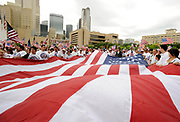 A giant American flag is unfurled in front of City Hall in Dallas, Texas during the MegaMarch for Immigration Reform  May 01, 2010.