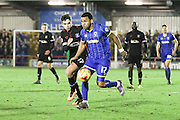 Battle of the 17's Andy Barcham of AFC Wimbledon & Alex Gilliead of Carlisle United FC chase the ball during the Sky Bet League 2 match between AFC Wimbledon and Carlisle United at the Cherry Red Records Stadium, Kingston, England on 23 February 2016. Photo by Stuart Butcher.