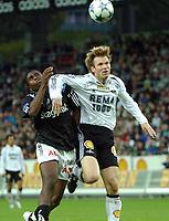 Fotball Tipeligaen Rosenborg ( RBK ) - Odd Grenland 6-0<br /> Bjørn Tore Kvarme holder Olivier Ocean unna<br /> Foto: Carl-Erik Eriksson, Digitalsport