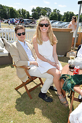 ALEXANDER CORDLE and FRANCESCA LECCHINI-LEE at the Jaeger-LeCoultre Gold Cup Polo Final held at Cowdray Park Polo Club, Midhurst, West Sussex on 19th July 2015