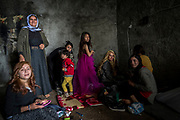 Women and children get ready inside a cave to celebrate the Yazidi New Year in Lalish in April 2018.