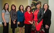 L-R: Houston ISD Parent & Community Relations team members Melissa Lopez, Marina Garcia, Alma Aguilar, Christina Oliveros, Ta Kisha Walker and Suzanne Mihaloglou pose for a photograph, December 12, 2013.