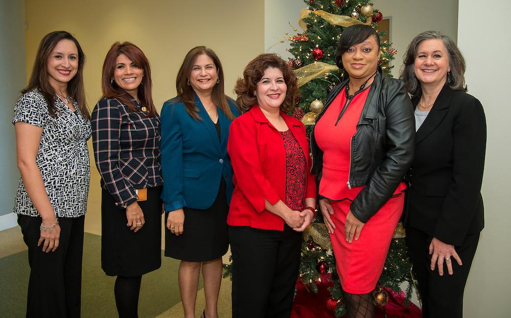 L-R: Houston ISD Parent & Community Relations team members Melissa Lopez, Marina Garcia, Alma Aguilar, Christina Oliveros, Ta Kisha Walker and Suzanne Mihaloglou pose for a photograph, December 12, 2013.