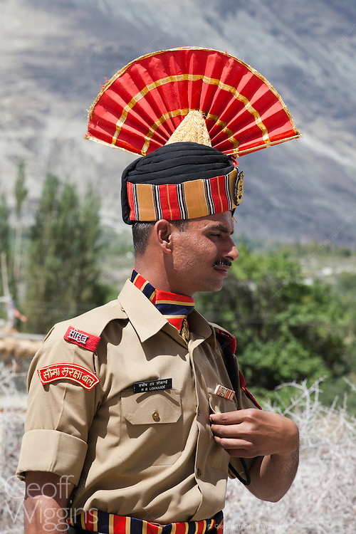 Members of India's Border Security Force in dress uniform attending memorial ceremony at Panamik Ladakh. The BSF is one of the Central Armed Police Forces. Its primary role is to guard India's international borders during peacetime and also prevent trans border crime.