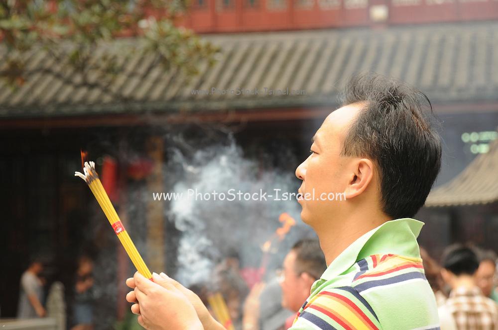 China, Shanghai, worshippers burning essence at the Jade Buddha Buddhist Temple