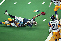 30 Jan 2000:  Kevin Dyson #87 of the Tennessee Titans reaches for the end zone with the ball as Mike Jones #52 of the St. Louis Rams tackles him on the last play of the game during the Super Bowl XXXIV Game at the Georgia Dome in Atlanta, Georgia. The Rams defeated the Titans 23-16.<br /> Mandatory Credit: Tom Hauck  /Allsport