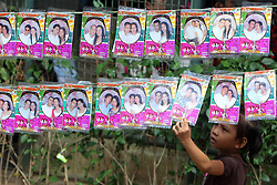 A girl looks at photos of couples during a Valentine s Day mass wedding in Quezon City, the Philippines, Feb. 14, 2013. About 4000 couples around the Philippines were married in celebration of Valentine s Day, February 14, 2013. Photo by Imago / i-Images...UK ONLY