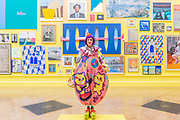 Grayson Perry poses in front of the works he curated Royal Academy celebrates its 250th Summer Exhibition, and to mark this momentous occasion, the exhibition is co-ordinated by Grayson Perry RA.