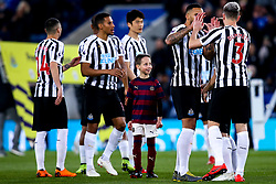 A young Newcastle United mascot looks up at Jamaal Lascelles and Paul Dummett of Newcastle United - Mandatory by-line: Robbie Stephenson/JMP - 12/04/2019 - FOOTBALL - King Power Stadium - Leicester, England - Leicester City v Newcastle United - Premier League