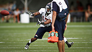 SHOT 7/25/13 9:48:54 AM - Denver Broncos wide receiver Kemonte' Bateman #13 stretches to make a catch as he runs through drills during opening day of the team's training camp July 25, 2013 at Dove Valley in Englewood, Co.  (Photo by Marc Piscotty / © 2013)