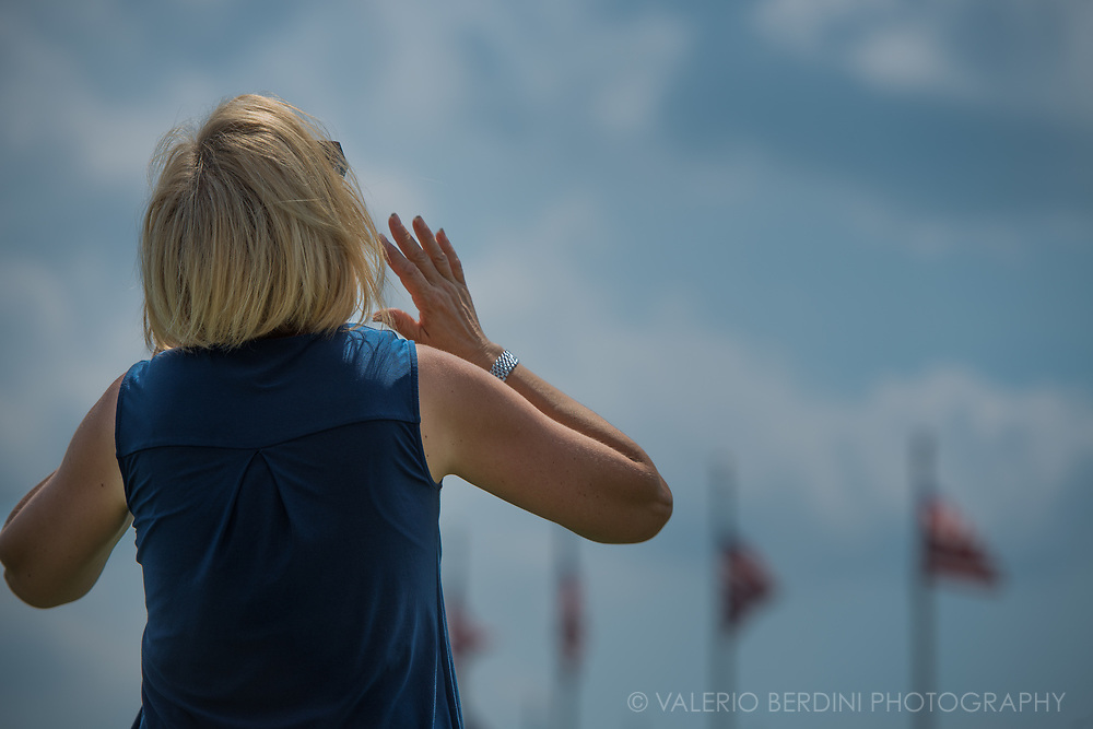 A woman marvels at the eclipse at the Washinton monument
