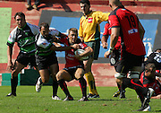 Cedric Rosalen (L) battles with Toulon's Pierre Mignoni. Montauban defeated big-spending Toulon 21-18 in the Top 14 on Sunday to cap a memorable week for the south-western club. Stade Sapiac, Montauban, France, 6th September 2009.