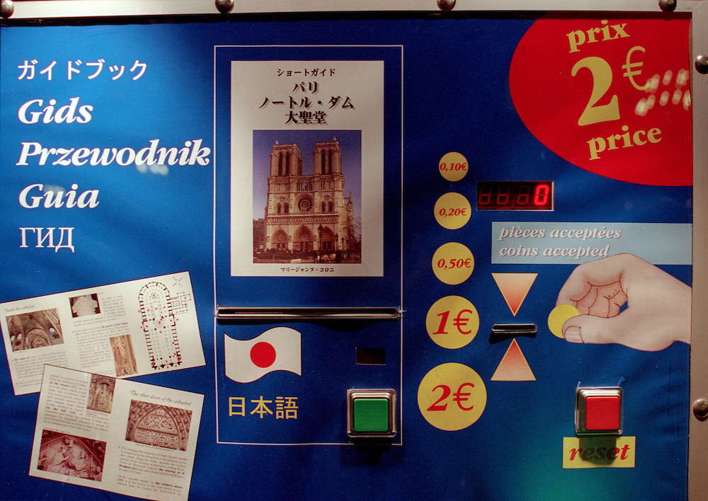 Brochures about the Notre Dame Cathedral in Paris, France, are for sale from a vending machine at the entrance on May 5, 2002. Built between 1163 and 1250, the church was heavily damaged during the French Revolution in the late 1700s. Extensive renovations were done, beginning in 1845. (Photo by Geoff Hansen)