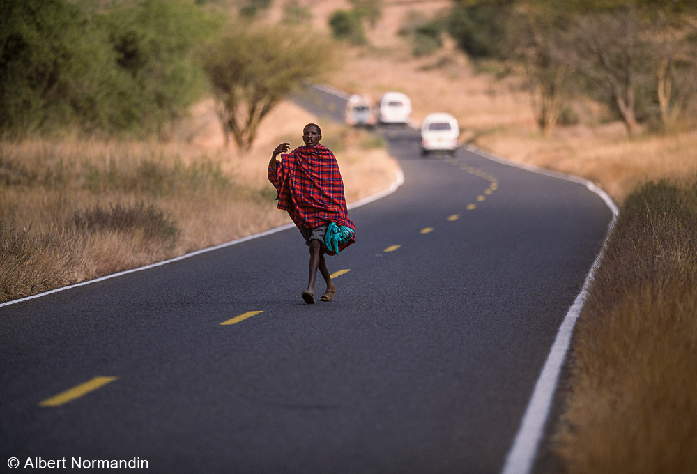 Maasai man crossing road, Kenya, July, 2002