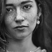 A 16-year-old Caucasian girl with red hair and freckles poses for her portrait in Chapel Hill, NC.