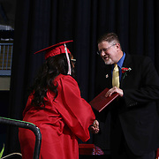 Conrad Schools of Science graduate india Dennis receives her diploma during Conrad commencement exercises Saturday, June 06, 2015, at The Bob Carpenter Sports Convocation Center in Newark, Delaware.