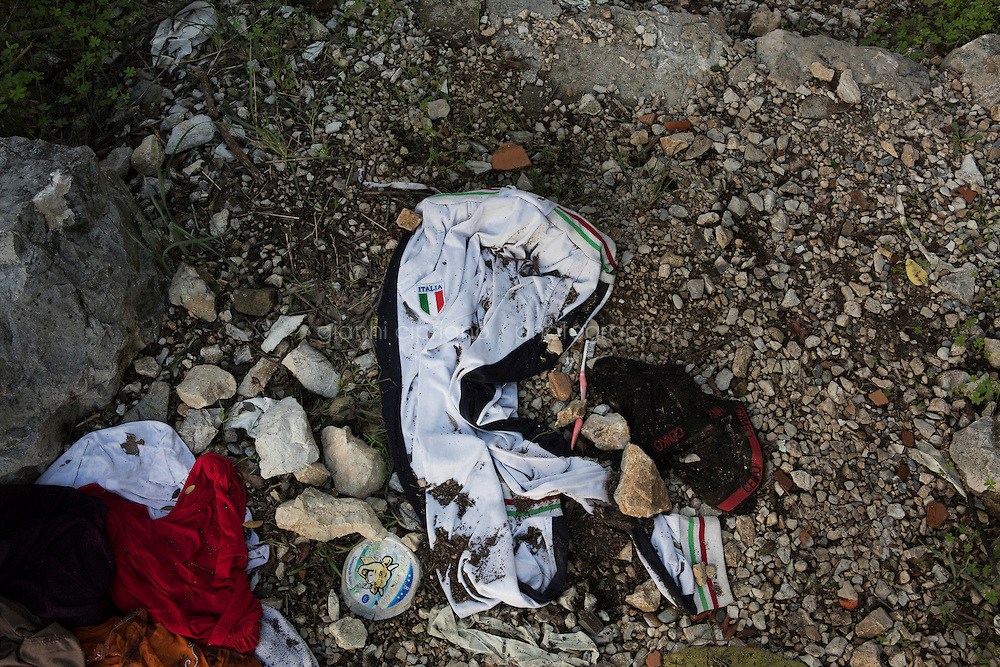 VENTIMIGLIA, ITALY - 20 NOVEMBER 2014: A tracksuit left by a migrant a trail near the Italian-French border  in Ventimiglia, Italy, on November 20th 2014.<br /> <br /> The Ventimiglia-Menton border is the border between Italy and France crossed by migrants who decide to continue their journey up north towards countries such as Germany, Sweden, The Netherlands and the UK where the process to receive the refugee status or humanitarian protection is smoother and faster. in Ventimiglia, Italy, on November 17th 2014.
