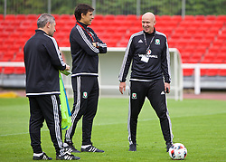 DINARD, FRANCE - Monday, July 4, 2016: Wales' manager Chris Coleman and head of pubic affairs Ian Gwyn Hughes during a training session at their base in Dinard as they prepare for the Semi-Final match against Portugal during the UEFA Euro 2016 Championship. (Pic by David Rawcliffe/Propaganda)