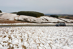 © Licensed to London News Pictures. 12/03/2019. Garth, Powys, Wales, UK. Temperatures drop dramatically to around zero deg C and snow falls on the Mynydd Epynt moorland near Garth in Powys, Wales, UK. as Storm Gareth arrives in Wales, UK. Photo credit: Graham M. Lawrence/LNP