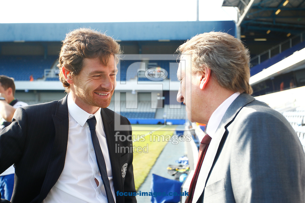 Picture by Andrew Tobin/Focus Images Ltd. 07710 761829. 23/10/11. Andre Villas Boas, manager of Chelsea (L) and Neil Warnock, manager of QPR (R) talk before the Barclays Premier League match between QPR and Chelsea at Loftus Road, London.
