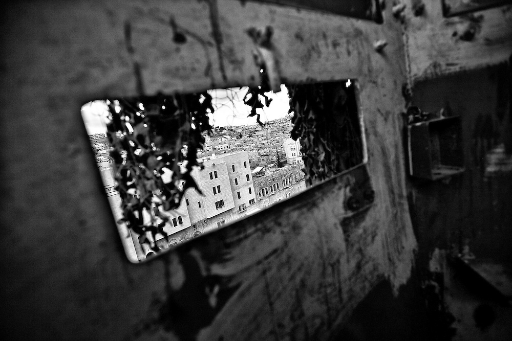 A view of the old city of Hebron from inside a vacant Israeli guard tower. Mar. 22, 2011. West Bank, Palestine.
