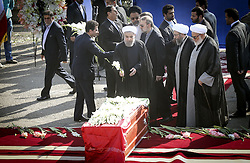 TEHRAN, Oct. 3, 2015 (Xinhua) -- Iranian President Hassan Rouhani (front C) lays flowers on coffines of dead pilgrims during a ceremony to pay tribute to 104 Iranian pilgrims killed in the latest Hajj stampede and transferred to Mehrabad airport in Tehran, capital of Iran, on Oct. 3, 2015. Rouhani on Saturday urged for an investigation into the latest Hajj stampede in Saudi Arabia which left 465 Iranian pilgrims dead. (Xinhua/Ahmad Halabisaz) (Credit Image: © Ahmad Halabisaz/Xinhua via ZUMA Wire)