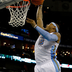 October 29, 2010; New Orleans, LA, USA; Denver Nuggets small forward Carmelo Anthony (15) dunks during the first half against the New Orleans Hornets at the New Orleans Arena.  Mandatory Credit: Derick E. Hingle