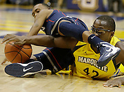 Marquette's Chris Otule(42) and Connecticut's Ryan Boatright, left, dive for a loose ball during the first half of an NCAA college basketball game Tuesday, Jan. 1, 2013, in Milwaukee. (AP Photo/Jeffrey Phelps)