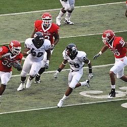 Sep 12, 2009; Piscataway, NJ, USA; Rutgers running back Jourdan Brooks (39) tries to outrun Howard cornerback Lanny Kelly (28) during the second half of Rutgers' 45-7 victory over Howard in NCAA college football at Rutgers Stadium