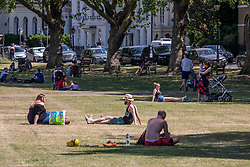 © Licensed to London News Pictures. 02/06/2020. London, UK. Members of the public go out in the sunshine in Richmond in South West London as weather experts predict another warm day with highs of 26c. Tomorrow a cold front with rain will hit the South East. On Monday, up to six people are now allowed to meet up in parks and private gardens. Photo credit: Alex Lentati/LNP