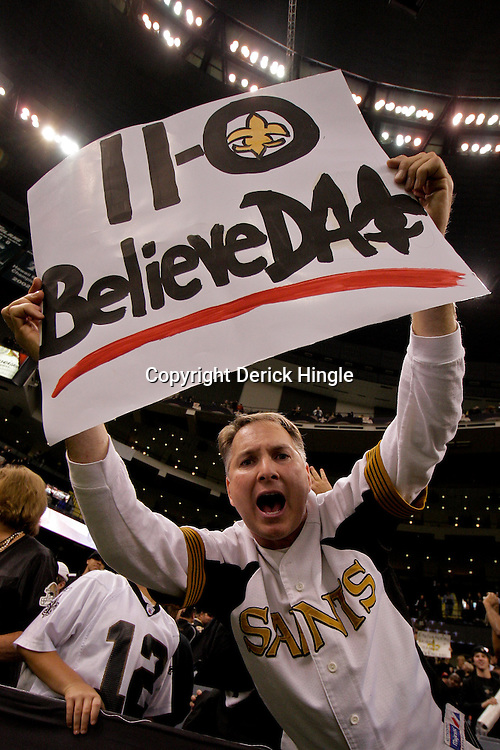 2009 November 30:  A New Orleans Saints fan holds up a sign following a 38-17 win by the New Orleans Saints over the New England Patriots at the Louisiana Superdome in New Orleans, Louisiana.