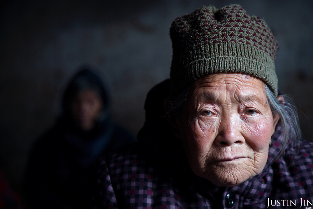Old people living in a Chinese village in Henan province survive on meagre savings. Many say they would like to be placed in modern housing blocks that the government is providing in exchange for knocking down farmland. <br /> <br /> China is pushing ahead with a dramatic, history-making plan to move 100 million rural residents into towns and cities over the next six years &mdash; but without a clear idea of how to pay for the gargantuan undertaking or whether the farmers involved want to move.<br /> <br /> Moving farmers to urban areas is touted as a way of changing China&rsquo;s economic structure, with growth based on domestic demand for products instead of exporting them. In theory, new urbanites mean vast new opportunities for construction firms, public transportation, utilities and appliance makers, and a break from the cycle of farmers consuming only what they produce.<br /> <br /> Urbanization has already proven to be one of the most wrenching changes in China&rsquo;s 35 years of economic reforms. Land disputes rising from urbanization account for tens of thousands of protests each year.