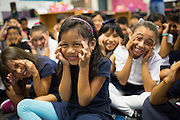Ileana Perez makes a face with her classmates as third grade teacher Laura Polden reads a book during the first day of school at Zanker Elementary School in Milpitas, California, on August 19, 2013. (Stan Olszewski/SOSKIphoto)