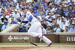 August 17, 2017 - Chicago, IL, USA - The Chicago Cubs' Anthony Rizzo hits an RBI double during the fifth inning against the Cincinnati Reds at Wrigley Field in Chicago on Thursday, Aug. 17, 2017. The Reds won, 13-10. (Credit Image: © Armando L. Sanchez/TNS via ZUMA Wire)