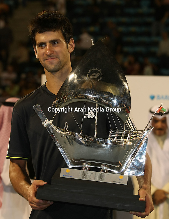 Novak Djokovic of Serbia poses with the trophy for singles match against David Ferrer of Spain in the finals of the Dubai Tennis Open, February 28, 2009. Photo by Dennis B. Mallari