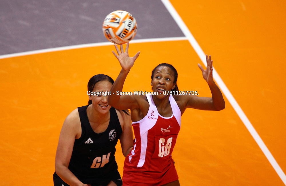 PICTURE BY VAUGHN RIDLEY/SWPIX.COM - Netball - World Netball Series 2010 - England v New Zealand Final - Echo Arena, Liverpool, England - 21/11/10.<br /> <br /> Copyright - Simon Wilkinson - 07811267706.<br /> <br /> England's Pamela Cookey and New Zealand's Rachel Rasmussen.