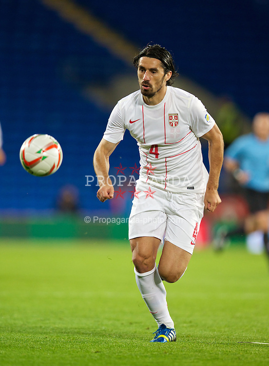 CARDIFF, WALES - Tuesday, September 10, 2013: Serbia's Milan Bisevac in action against Wales during the 2014 FIFA World Cup Brazil Qualifying Group A match at the Cardiff CIty Stadium. (Pic by David Rawcliffe/Propaganda)