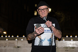 London, UK. 15th March, 2019. A man reads out the names of homeless people who have died at a vigil by campaigners against homelessness from groups including Streets Kitchen and Disabled People Against Cuts (DPAC) opposite Downing Street to commemorate 799 homeless people who have died over the last 18 months and to call for an end to the cuts to services which result in homelessness and the increasing criminalisation of those experiencing homelessness.