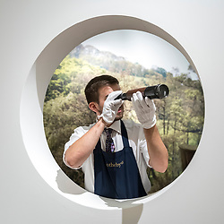 "© Licensed to London News Pictures. 26/10/2018. LONDON, UK. A staff member presents ""Edward Prince of Wales' telescope"", (Est GBP800-1,200).   Preview of ""A Private View, property from the country home of Christopher Cone and Stanley J. Seeger"" at Sotheby's, New Bond Street.  Over 200 extraordinary works will be auctioned in London on 30 October 2018.  Photo credit: Stephen Chung/LNP"