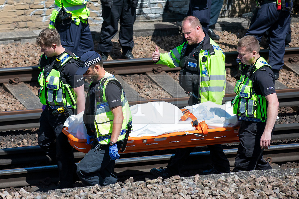 © Licensed to London News Pictures. 18/06/2018. London, UK. Emergency services carry away bodies from near Loughborough Junction station after it was reported that three people have been killed after being hit by a train. Photo credit: Rob Pinney/LNP